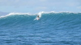 Surfer Towed Into Large Blue Wave