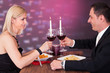 Portrait Of Happy Couple In Restaurant