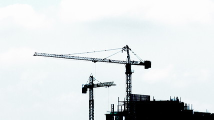 construction site silhuette on bright sky background close up