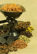 Spices and old weighing scales on hessian background