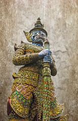 Ancient giant sculpture of The Emerald Buddha temple in Bangkok,