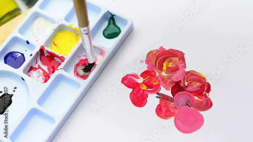 artist filling water color on art board