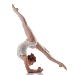 Image of young slender girl doing acrobatic stunt