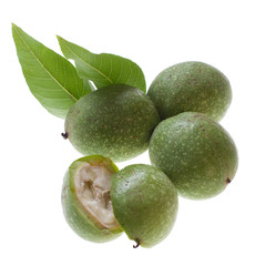 raw green walnut on white background