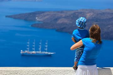 family looking at Santorini, Greece