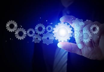 Businessman hand show gear to success concept