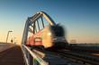Train speeding over bridge.