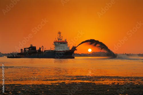 A dredging ship in action at Palm Jumeirah, Dubai, UAE - 54353737