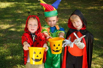 Three boys in halloween costumes trick or treating