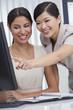 Asian Chinese & Hispanic Businesswomen Using Office Computer