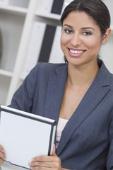 Hispanic Latina Woman Businesswoman Using Tablet Computer