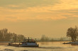 Riverboat during winter on the river IJssel in The Netherlands - 54356943