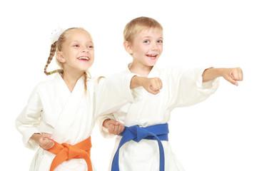 Funny athletes in kimono beat hand