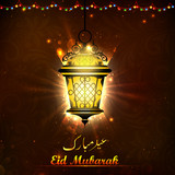 Illuminated lamp on Eid Mubarak background