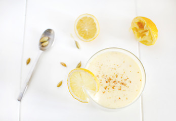 Milkshake with banana and mango, lemons, cardamom smoothie