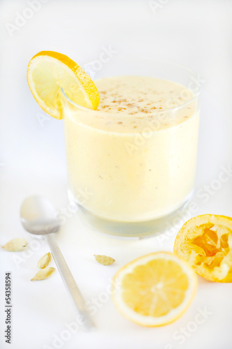 Fruit juice smoothie or milkshake with lemon and cardamom