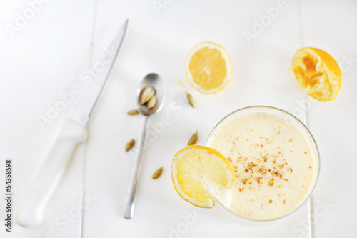 Mango and banana yoghurt smoothie lassi with lemons and cardamom
