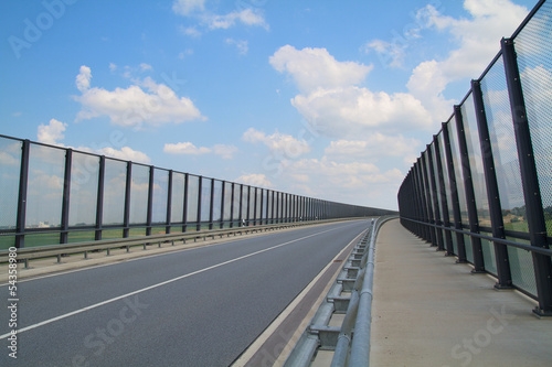 Highway with noise barrier