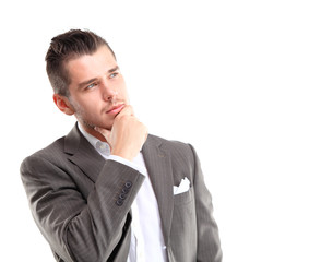 Young handsome man looking at copy-space thinking or dreaming