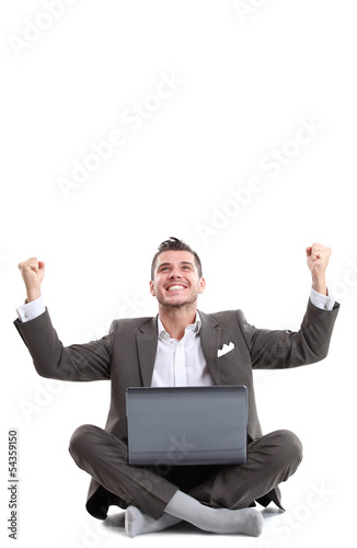 Business man celebrating his success with a computer laptop