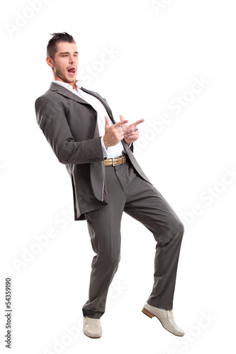 Young surprised business man pointing at something interesting