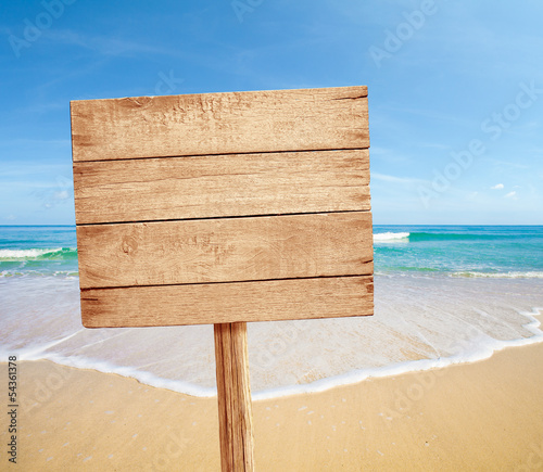 wood road sign on sea beach