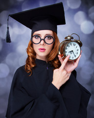 Redhead student with big clock