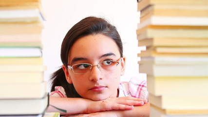 Girl Overwhelmed with Reading Books