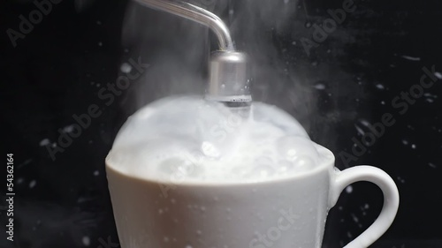 Hot milk goes out of the cup.
