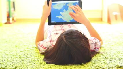 Teenage Girl Searching Maps on Digital Tablet