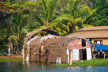 Old wattled houseboat on Kerala backwaters. Kerala, India