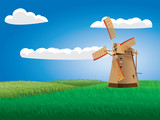 Windmill on grass field