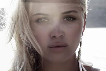 Beautiful blond woman on the beach. light on tha face.sunset