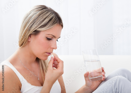 Portrait of woman taking pills