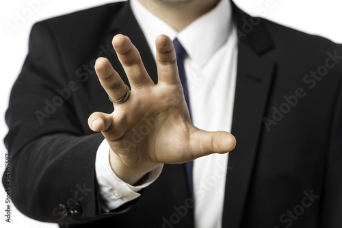 Businessman in a suit holds out his hand