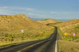 Winding Road in a Desert Landscape at Sunset poster