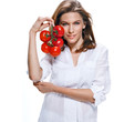 Young beautiful woman with bunch of tomatoes in hand