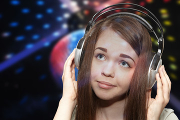 The girl in headphones on a disco