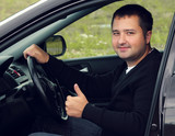 happy man driving a car