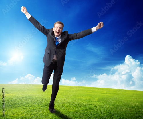 happy business man running on spring field