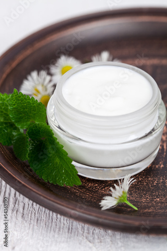 container with cream urtica and chamomiles