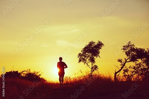 Running at the sunset - back lit