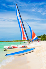 Marina with colorful catamarans  at a beach in Cuba