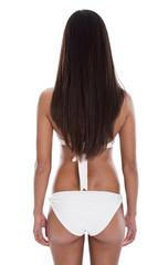 Körper einer jungen schlanken Frau isoliert auf Weiß