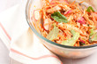 Chicken salad with carrots, spinach and radishes