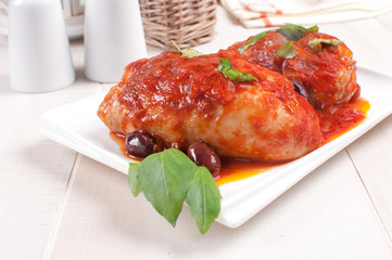 Chicken thighs sauteed with tomato and olives