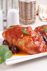 Braised chicken with tomato sauce and olives
