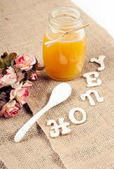 Honey jar with sign from wooden letters