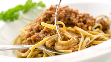 Rolling spaghetti bolognese on a fork