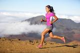 Runner woman athlete running sprinting fast